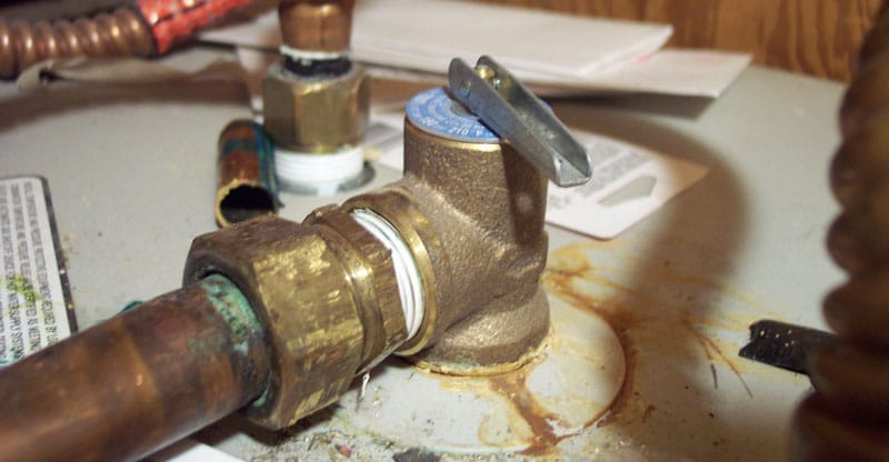How do you repair a leaking water heater pressure relief valve?